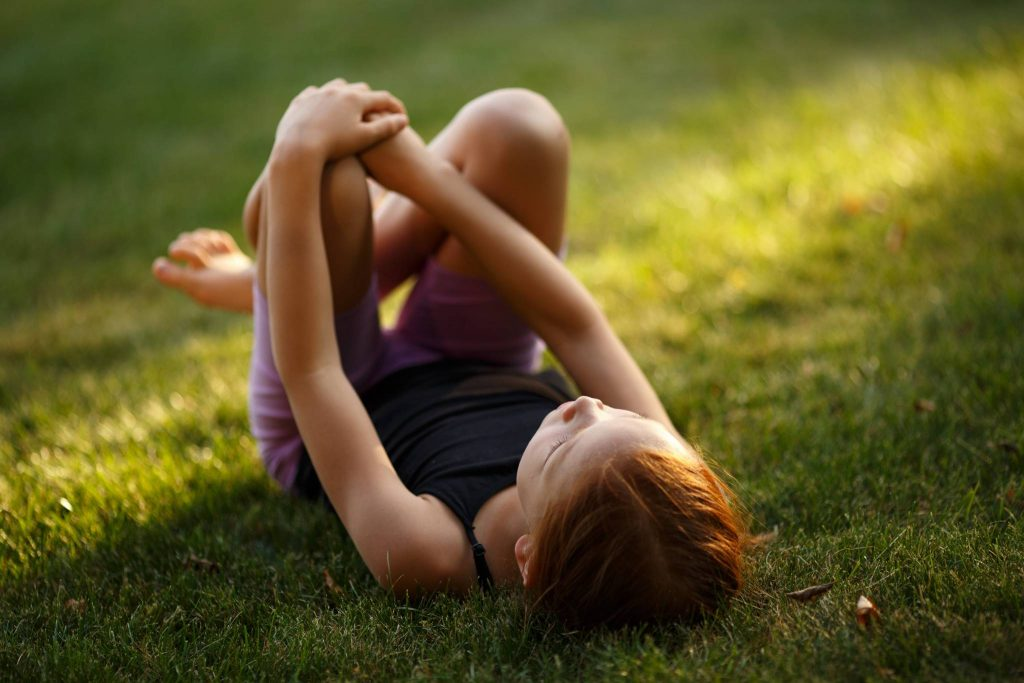 Outdoor activities for kids - rolling down a hill